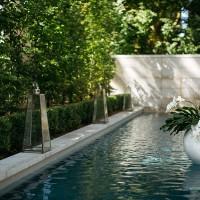 Backyard wedding floral arrangement in pool